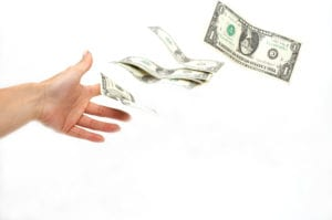 Image of hand throwing money away